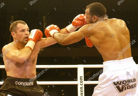 BOXING German boxer Sven Ottke, left, strikes Thomas Tate from the United States of America in the super middleweight IFB-Championship at the Arena in Nuremberg, Germany, on