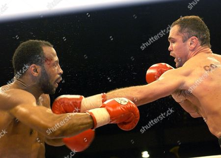 Stock Picture of BOXING German boxer Sven Ottke, right, strikes Thomas Tate from the United States of America in the super middleweight IFB-Championship at the Arena in Nuremberg, Germany, on