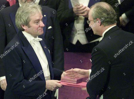 NURSE KING British scientist Sir Paul Nurse, left, receives the Nobel prize 2001 for Medicine from Swedish king Carl XVI Gustaf during the award ceremony at the concert hall in Stockholm, Sweden