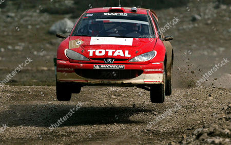 Britain's Richard Burns drives his Peugeot 206 WRC during the third day of the Rally of Turkey in the Mediterranean coastal town of Kemer, southern Turkey, . The Rally of Turkey, the third leg of the World Rally Championship, recently replaced Kenya's cash-strapped Safari Rally on the 2003 calendar