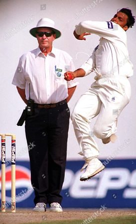 Stock Picture of SHARJAH CRICKET Pakistan's fast bowler Shoaib Akthar in action, against the West Indies team, on the final day of First Test in Sharjah, U.A.E. Akthar claimed five wickets for 24 runs against the West Indies. England umpire George Sharp looks on
