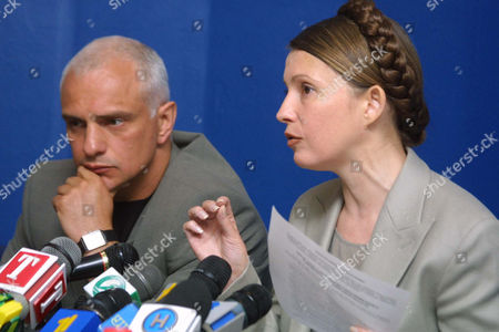 Stock Photo of TYMOSHENKO Ukraine's ex-Deputy Premier and an opposition leader Julia Tymoshenko, right, addresses the media as her husband Oleksandr Tymoshenko listens, at a wews conference in Kiev, Ukraine, . A Ukrainian court justified Tymoshenko and her husband and closed corruption cases against them, saying they were illegal. Tymoshenko was charged with stealing and illegally exporting Russian natural gas and giving bribes to ex-Premier Pavlo Lazarenko, while her husband was charged with misappropriate state funds in metal-trading deals. Tymoshenko numerously claimed the charges against her and her husband were orchestrated by her political opponents