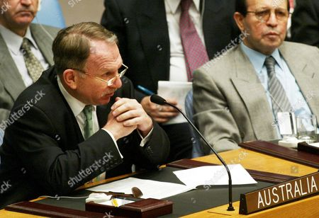 """DAUTH Iraq's U.N. Ambassador Mohammed Al-Douri, right, listens as Australian Ambassador John Dauth speaks at a meeting of the Security Council at the United Nations . Dauth said """"Australia does not believe Iraq has had a change of heart"""