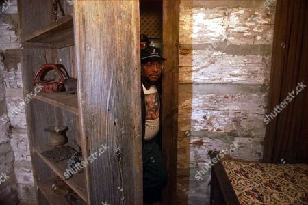WALLS Allen Walls looks out from behind a fake book shelf at their Underground Railroad museum in Lakeshore Township, Ontario in Feb. 2001. The museum was built around the house built by their great grandfather John Freeman Walls in 1846, a year after the former slave escaped from North Carolina