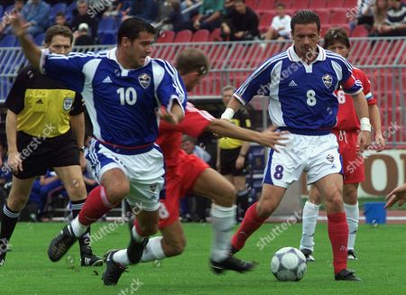 STANKOVIC MIJATOVIC POSING Yugoslav national team players Dejan Stankovic, left, and Predrag Mijatovic, right, battle for the ball with Luxembourg national team player Patrick Posing, center, during their World Cup Qualifier soccer match, in Belgrade, on
