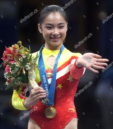 LIU Liu Xuan of China waves during the medals ceremony for balance beam during the gymnastics apparatus finals at the 2000 Summer Olympic Games in Sydney, . Liu won the gold medal in the event