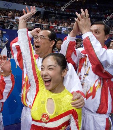 LIU Liu Xuan of China reacts after winning the gold medal on the balance beam during the gymnastics apparatus finals at the 2000 Summer Olympic Games in Sydney