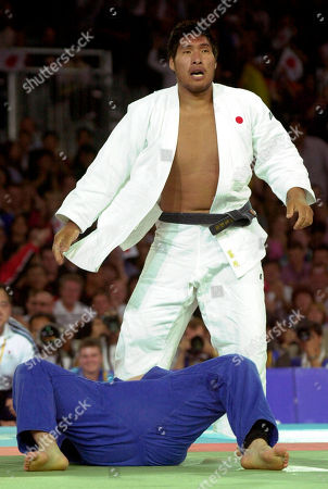 Shinichi Shinohara, Tamerlan Tmenov Japan's Shinichi Shinohara stands up after pinning down his opponent,Tamerlan Tmenov from Russia, during the semifianls competition in the 100 kg men's judo competition at the XXVII Summer Games in Sydney