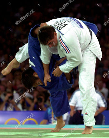 Shinichi Shinohara, David Douillet Japan's Shinichi Shinohara, blue, and France's David Douillet battle for a throw in the finals of the over 100 kg judo competition at the Summer Olympic Games in Sydney . Douillet won the gold medal