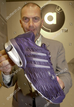 """Stock Photo of ADIDAS Erich Stamminger, Chairman of Adidas-Salomon AG, presents the new sports shoe generation of Adidas, called """"a3"""", in Herzogenaurach, Germany, on Friday, July, 13, 2001. The new shoe will better absorb and has a better stability for the foots. The shoe will come out in summer 2002"""
