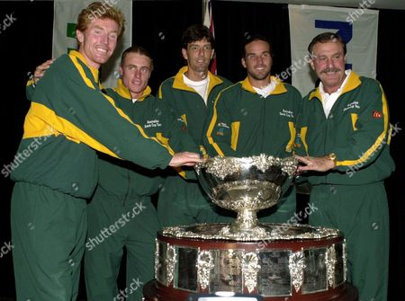 AUSTRALIAN TEAM Australian Davis Cup tennis players smile with the Davis Cup after the draw for their semifinal match against Brazil in Brisbane, Australia, . They are, from left: Mark Woodforde, Lleyton Hewitt, Sandon Stolle, Pat Rafter and captain John Newcombe. Rafter will play French Open champion Gustavo Kuerten of Brazil in the first match on Friday