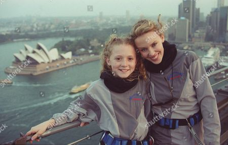 MINOGUE WEBSTER World famous singer Kylie Minogue and young Olympic opening ceremony's star Nikki Webster stand together on top of the Sydney Harbour Bridge