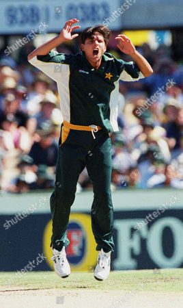 AFRIDI Pakistani bowler Shahid Afridi leaps up in the air as he appeals against Australian opening batsman Mark Waugh during the second one day-night final in Sydney, Australia, . Waugh was given not out
