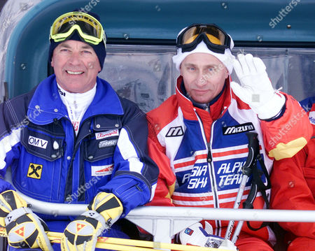 Russian President Vladimir Putin, right, waves as he takes a chair lift accompanied by Austrian ski legend Karl Schranz in St. Christoph, Austria . Putin enjoyed a skiing session before heading off to nearby St. Anton to attend the final events of the 2001 World Alpine Ski Championships