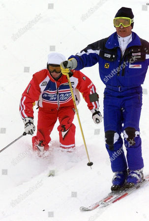 Russian President Vladimir Putin, left, skis into deep snow as he is accompanied by Austrian ski legend Karl Schranz, right, on the slopes in St. Christoph, Austria . Putin enjoyed a skiing session before heading off to nearby St. Anton to attend the final events of the 2001 World Alpine Ski Championships