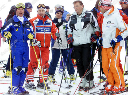 Russian President Vladimir Putin, 2nd left, stands with Austrian Chancellor Woflgand Schuessel, 2nd right, Austrian ski legend Karl Schranz, left, and Peter Schroeksnadel, right, the President of the Organising Committee of the 2001 World Alpine Ski Championships, on the ski slopes in St. Christoph, Austria . Putin enjoyed a skiing session before heading off to nearby St. Anton to attend the final events of the 2001 World Alpine Ski Championships. Woman at center is unidentified