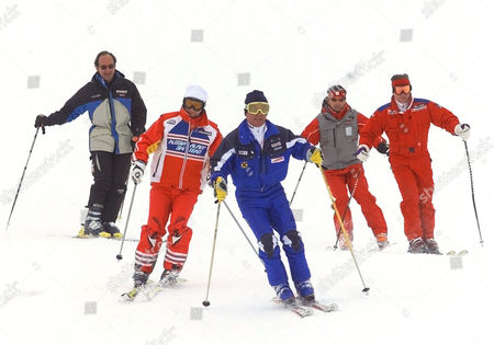 Russian President Vladimir Putin, 2nd left, and Austrian ski legend Karl Schranz, center, ski on the slopes in St. Christoph, Austria . Putin enjoyed a skiing session before heading off to nearby St. Anton to attend the final events of the 2001 World Alpine Ski Championships. Others in photo are unidentified