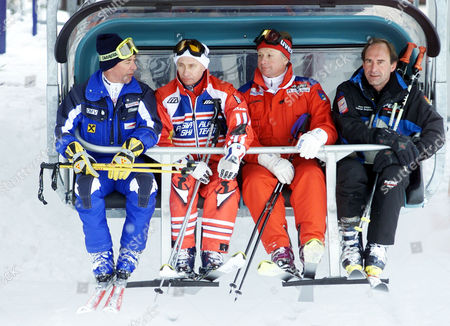 Russian President Vladimir Putin, 2nd left, and Austrian ski legend Karl Schranz, left, take a chair lift in St. Christoph, Austria . Putin enjoyed a skiing session before heading off to nearby St. Anton to attend the final events of the 2001 World Alpine Ski Championships. Others in photo are unidentified