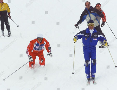 Russian President Vladimir Putin, left, skis into deep snow as he is accompanied by Austrian ski legend Karl Schranz, right, on the slopes in St. Christoph, Austria . Putin enjoyed a skiing session before heading off to nearby St. Anton to attend the final events of the 2001 World Alpine Ski Championships. Others in photo are unidentified