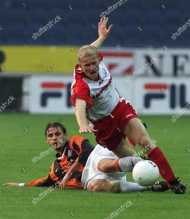 NEMEC DIMITROVIC GAK's Boban Dimitrovic, right, falls over Miroslav Nemec from Kosice, during the UEFA Cup first round second leg match GAK vs Kosice from Slovakia at the Schwarzenegger stadium in Graz, Austria