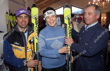 Italian ski stars Kristian Ghedina, left, and Isolde Kostner meet with Austrian skiing legend Karl Schranz, right, at a ski racing team presentation at the World Alpine Ski Championships in St. Anton, Austria
