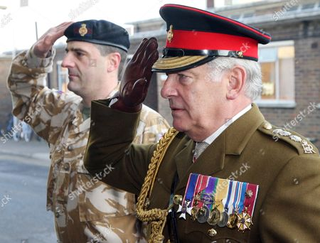Members of the Household Cavalry Regiment receive Iraq Campaign Medals from General Lord Guthrie at their barracks in Windsor following their tour in Iraq patrolling Maysan province and Basra.