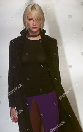 EQUILIBRIO COLLECTION Brazilian model Ana Claudia Michels sports an outfit for the Winter 2001 collection of Brazilian Equilibrio at the Sao Paulo Fashion Week in Sao Paulo, Brazil on