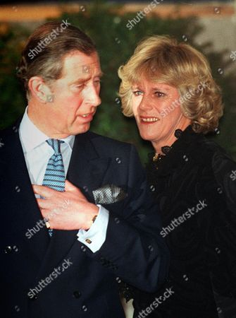 CHARLES CAMILLA Britain's Prince Charles and his friend Camilla Parker Bowles leave the Ritz Hotel in London, after attending the 50th birthday party of Camilla's sister, Annabel Elliott. It is the first time that the couple, who have been friends for more than 25 years, have appeared together in public, at last giving Britain's photographers the picture they've been seeking for years