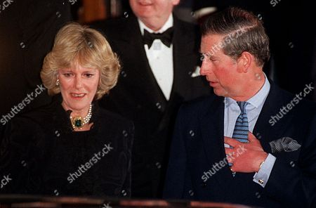 Britain's Prince Charles and his friend Camilla Parker Bowles leave the Ritz Hotel in London, after attending the 50th birthday party of Camilla's sister, Annabel Elliott. It is the first time that the couple, who have been friends for more than 25 years, have appeared together in public, at last giving Britain's photographers the picture they've been seeking for years