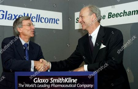 Sir Richard Sykes, left, Chairman of Glaxo Wellcome, and Jean-Pierre Garnier, Chief Executive officer of SmithKline Beecham shake hands for reporters in Central London, after their announcement of the proposed merger of the two pharmaceutical companies. The new company called Glaxo SmithKline, would hold a 7.3 percent share of the global pharmaceutical market and have a combined market value in excess of $182 billion