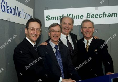 Sir Richard Sykes, Chairman of Glaxo Wellcome, second left, and Jean-Pierre Garnier, Chief Executive officer of SmithKline Beecham third left, in central London, with John Coombe, left, Finance Director of Glaxo Wellcome and Chief Financial officer of the proposed merged company, and Jan Leschly, right, former Chief Executive of SmithKline, after their announcement that Glaxo will buy it's rival SmithKline for about $76 billion dollars. The deal would create a company thatwould hold a 7.3 percent share of the global pharmaceutical market and have a combined market value in excess of $182 billion