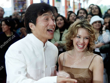 Stock Picture of Kong Kong actor Jackie Chan jokes as he arrives with Australian singer Kylie Minogue for the Indian International film awards at London's Millennium Dome . India's biggest film stars were honored at their cinematic equivalent of the Oscars
