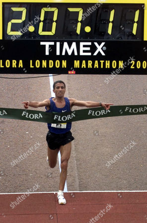 Abdelkhader El Mouaziz from Morocco wins the annual London Marathon in a time of 2:07:11 as he crosses the line in the Mall in London . This is the 21st running of the London Marathon. Kenyan Paul Tergat was second and last year's winner Antonio Pinto from Portugal was third