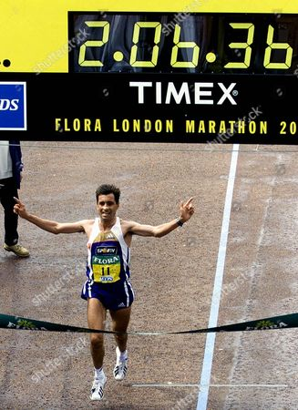 PINTO The men's winner of the London Marathon, Antonio Pinto, from Portugal, crosses the finish line to beat the European and London course records in 2 hours, 6 minutes and 36 seconds