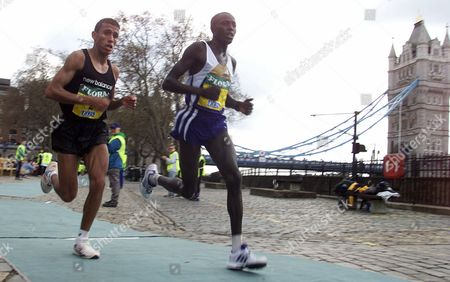KHANNOUCHI KIPLAGAT Khalid Khannouchi, of Morocco, left, runs with William Kiplagat of Kenya as they pass Tower Bridge during the men's race in the London Marathon, . Portugal's Antonio Pinto won the race with a new course record time of 2.06:33. Khannouchi finished third with a time of 2.07:33