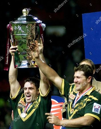 FITTLER STEVENS Australia's captain Brad Fittler, left, holds the Rugby league World cup as teammate Jason Stevens joins in the celebration after winning the final of the Rugby League World cup 2000, against New Zealand in the Old Trafford stadium, Manchester