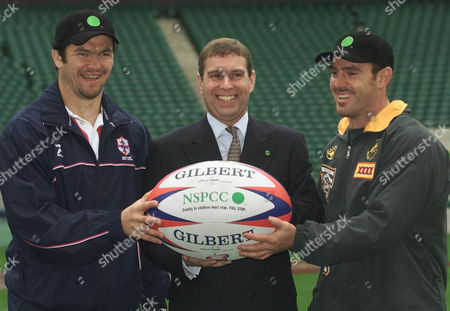 Stock Image of CUP Prince Andrew, the Duke of York with English Captain Andy Farrell, left, and Australian Captain Brad Fittler, right, at Twickenham Rugby Ground in West London, . The Duke met with the two Rugby League teams, England and Australia, that will take part in the opening game of the Rugby League World Cup to be held at Twickenham Stadium on Saturday October 28, 2000