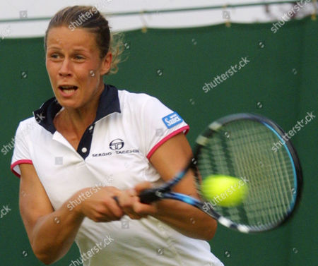 Germany's Jana Kandarr returns to Spain's Ana Isabel Medina Garrigues, during their women's singles, first round match at Wimbledon