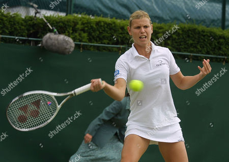 Germany's Anke Huber, plays a return to Elena Dementieva from Russia, during their third round women's singles match at Wimbledon
