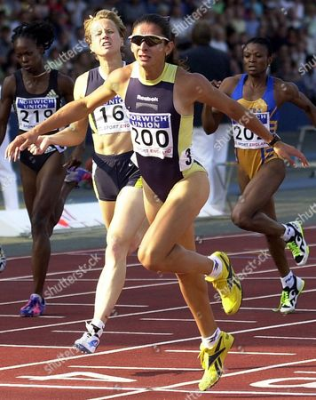 Ana Guevara of Mexico, foreground, comes in to win the womens 200 metre race with 50.12 seconds in fornt of Katharine Merry of Great Britain, centre, and Monique Hennagan of the Ubited States, left, and Charity Opara of Niger during the British Grand Prix Athletics event at London's Crystal Palace Stadium