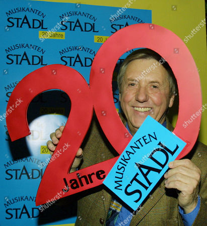 """MOIK Austrian entertainer Karl Moik poses with a big """"20"""" during a celebrity party for the 20th jubilee of the tv-show """"Musikanten-Stadl"""" in Munich on"""