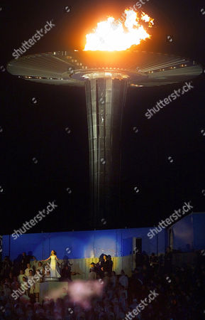 Stock Photo of WEBSTER Nikki Webster, 13, performs near the Olympic flame just before it was officially exstinguished during closing ceremonies of the Summer Olympics, at Olympic Stadium in Sydney