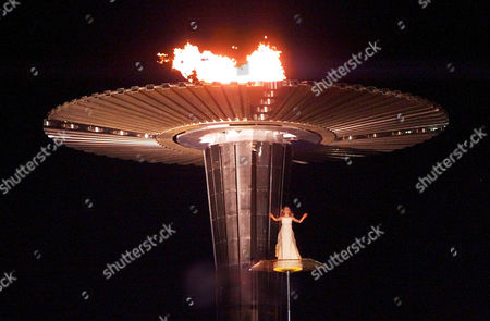WEBSTER Nikki Webster, 13, performs near the Olympic flame just before it was officially exstinguished during closing ceremonies of the Summer Olympics, at Olympic Stadium in Sydney
