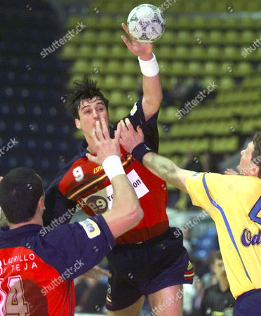 Marian Martinez Ortega of Spain, center aims a goal between Juan Marquez Perez and Thomas Sivertsson of Sweden during semifinal match of 2000 European Championship, in Zagreb, Croatia