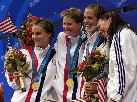 DYKEN The U.S. women's 4x100 freestyle relay team celebrate winning the gold medal during the medal ceremony at the Summer Olympics at the International Aquatic Centre in Sydney. From left are Jenny Thompson, Courtney Shealy, Dara Torres and Amy Van Dyken. The team also set a world record with a time of 3:36.61