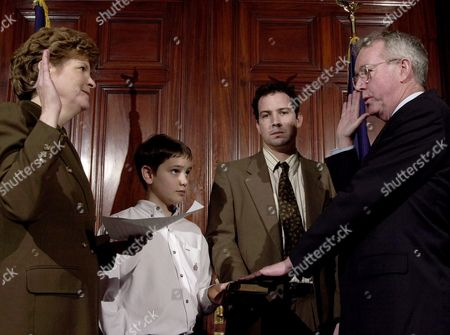SHAHEEN DUGGAN With his sons Brian, 29, second right, and Brendan, 12, second left, holding the Bible, Gov. Jeanne Shaheen, D-N.H., left, swears in State Supreme Court Justice James Duggan. As the long-time head of the state's appellate defender program, Duggan has represented hundreds of poor people before the Supreme Court. Duggan replaces Justice Sherman Horton, who resigned in November
