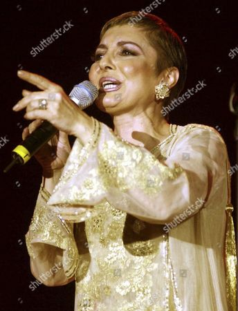 """Stock Picture of Iranian pop star Googoosh performs during a concert in Dubai, United Arab Emirates. Googoosh has released a video that addresses homosexual love, a major gesture by one of the country's top cultural figures in exile, causing shockwaves in the Islamic republic. Googoosh sings """"don't tell me to stop loving: you can't do that and I can't either."""" Googoosh was Iran's first pop diva, though the 1979 revolution ended her live singing career for two decades until she immigrated to the West. Navid Akhavan, an Iranian-born German who wrote and directed the video for Googoosh's song """"Behesht"""" (Heaven), said it has been viewed by more than a million Iranians online or via illegal satellite channels since its Valentine's Day release"""