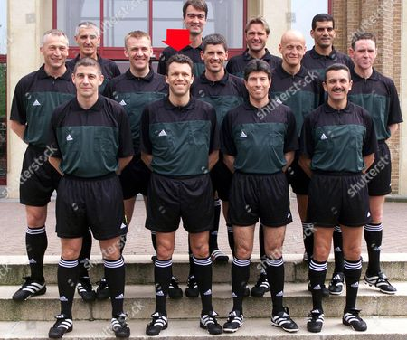 ARCHIV - The 13 referees working during the Euro 2000 soccer Championships in Belgium and the Netherlands pose during a photo opportunity in Brussels, on April 30, 2000. From left to right bottom row are: Gilles Veissiere of France, Markus Merk of Germany (marked with red arrow), Vitor Manuel Melo Pereira (Portugal), Jose Maria Garcia Aranda of Spain. Second row: Dick Jol (Netherlands), Graham Poll (England), Urs Meier (Switzerland), Pierluigi Collina (Italy), Hugh Dallas (Scotland). Top row: Guenther Benkoe (Austria), Kim Milton Nielsen (Denmark), Anders Frisk (Sweden) and Gamal El Ghandour (Egypt). Markus Merk will referee the semifinal match between the Netherlands and Italy, to be the first German referee in the round of the last four since 28 years