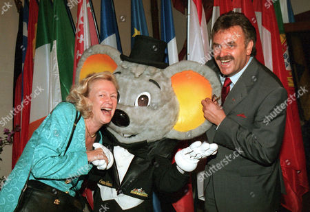 "FONTAINE MACK Nicole Fontaine, left, President of the European Parliament, left, and Roland Mack, director of the ""Europapark"" leisure park, right, joke withe the ""Europe Mouse"", the mascot of the park, . They met in Rust for the traditional annual asparagus dinner of the European Parliament somewhere in the region around Strasbourg. This year it's the first time in 30 years that the politicians met on the German side of the Rhine"