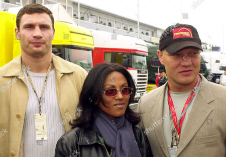 Ukranian boxer Vitali Klitchko, left, German singer Sabrina Setlur and former boxer Axel Schulz, right, are pictured in the pit lane prior to the Formula One European Grand Prix at the Nuerburgring circuit, . The Nuerburgring is the Indianapolis of German auto racing, located about 100 kilometers (60 miles) southwest of Cologne